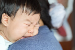 Adorable baby girl cry on mom shoulder. Adorable baby girl cry on mom shoulder Stock Photos