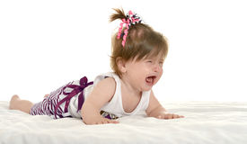 Adorable baby girl crying. On a white background Stock Photo