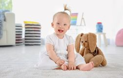 Adorable baby girl with cute toy. At home royalty free stock images