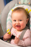 Adorable baby girl eating a pickle for the first time Stock Photo
