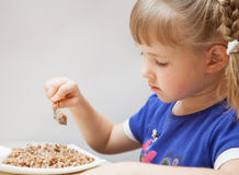 Adorable baby girl eating porridge Royalty Free Stock Photography