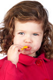Adorable baby girl eating sweets Royalty Free Stock Photography