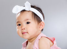 Adorable baby girl. With gray background Royalty Free Stock Photos