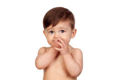 Adorable baby girl with the hands in her mouth Royalty Free Stock Photography