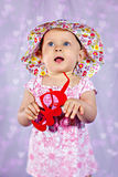 Adorable baby girl with heart sunglasses Stock Image