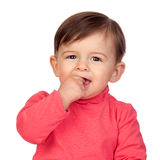 Adorable baby girl with her hand in mouth Stock Photos