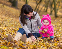 Adorable baby girl with her mother Stock Photo