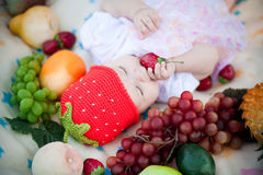 Adorable Baby Girl In The Fruits Royalty Free Stock Images