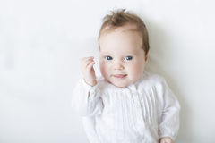 Adorable baby girl laughing toothless on a white b Stock Image
