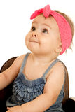 Adorable baby girl looking up wearing a pink headband Stock Photography