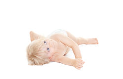 Adorable baby girl lying down and looking up Royalty Free Stock Photo
