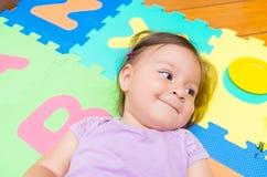 Adorable baby girl lying smiling Royalty Free Stock Image