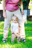 Adorable baby girl making first steps Royalty Free Stock Photo