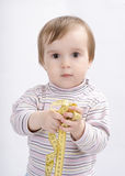 Adorable baby girl with a measuring tape Stock Photo