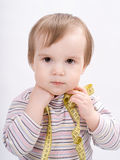 Adorable baby girl with a measuring tape Royalty Free Stock Images