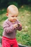 Adorable baby girl playing outside stock photography
