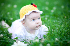 Adorable baby girl outdoors in the grass Stock Photography