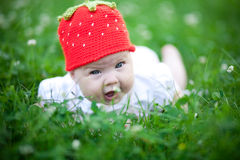 Adorable baby girl outdoors in the grass Stock Photo