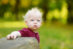 Adorable baby girl in a park Royalty Free Stock Photography