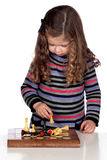 Adorable baby girl playing chess Royalty Free Stock Images