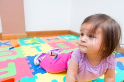 Adorable baby girl playing on floor Stock Images