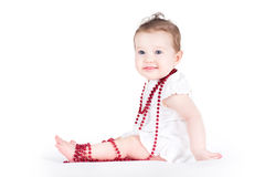 Adorable baby girl playing with a necklace Royalty Free Stock Photography