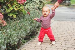 Adorable baby girl playing outside Stock Photos