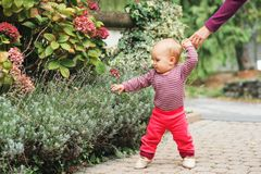 Adorable baby girl playing outside Stock Images