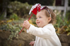 Adorable Baby Girl Playing with a Toy in Park Royalty Free Stock Images