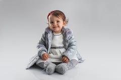 Adorable baby girl portrait on grey background Stock Image