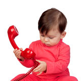 Adorable baby girl with a red phone Stock Image