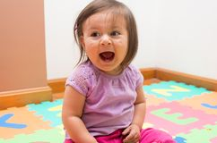Adorable baby girl screaming Stock Image