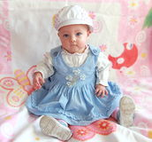 Adorable baby girl sitting royalty free stock photo