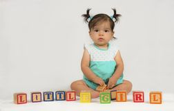 Mixed race baby with toy blocks royalty free stock photo