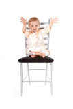 Adorable baby girl sitting on a chair Royalty Free Stock Photo