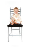 Adorable baby girl sitting on a chair Royalty Free Stock Photos