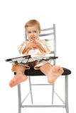 Adorable baby girl sitting on a chair and thinking Royalty Free Stock Photos