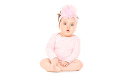 Adorable baby girl sitting on the floor Royalty Free Stock Image