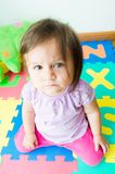 Adorable baby girl sitting on knees Stock Photography