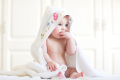 Free Adorable Baby Girl Sitting Under A Hooded Towel After Bath Stock Photography - 41227202