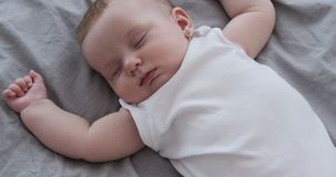 Baby girl sleeping on bed. Adorable baby girl sleeping on bed at home stock video footage