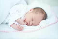 Adorable Baby Girl is Sleeping on Bed Stock Image