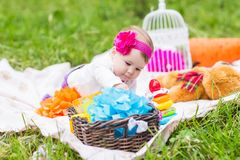Adorable baby girl smile picnic playful weekend nature stock photos