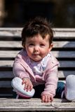 Cute baby girl laughing wearing jeans Royalty Free Stock Photography