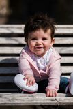 Cute baby girl laughing wearing jeans Royalty Free Stock Photo