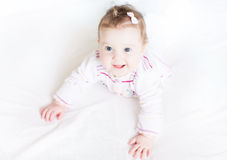 Adorable baby girl starting to crawl Royalty Free Stock Images