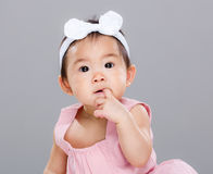 Adorable baby girl suck finger Royalty Free Stock Photo