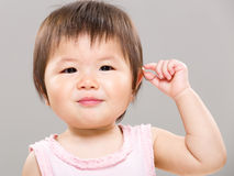 Adorable baby girl touch ear Stock Image