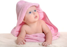 Adorable baby girl under a pink towel Stock Image