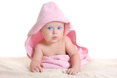 Adorable baby girl under a pink towel Royalty Free Stock Photo